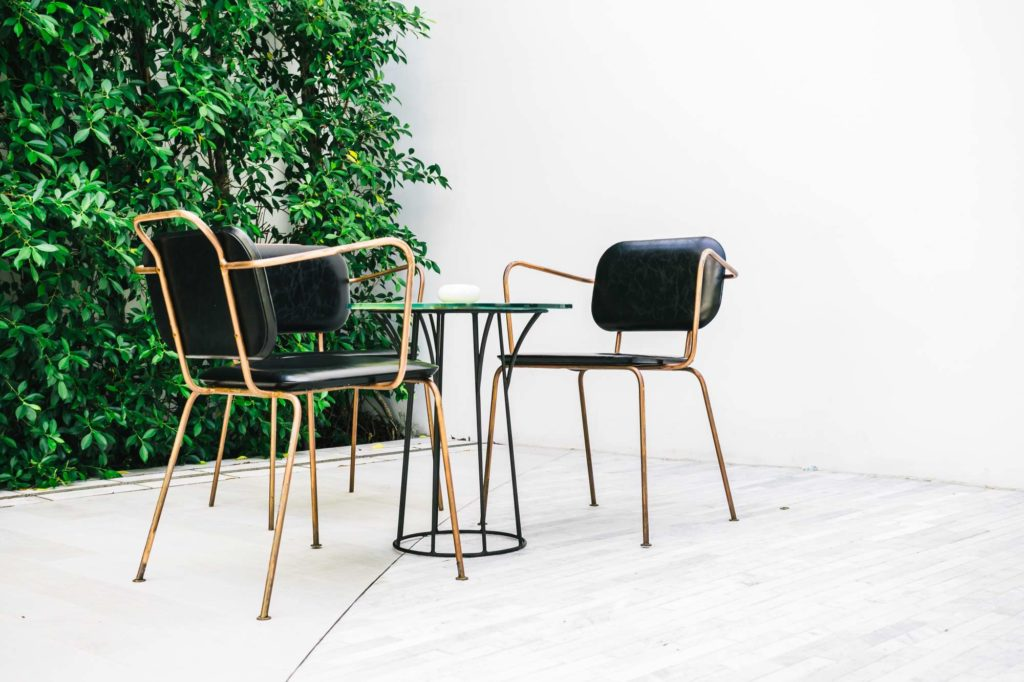 Furnitures with empty chair and table
